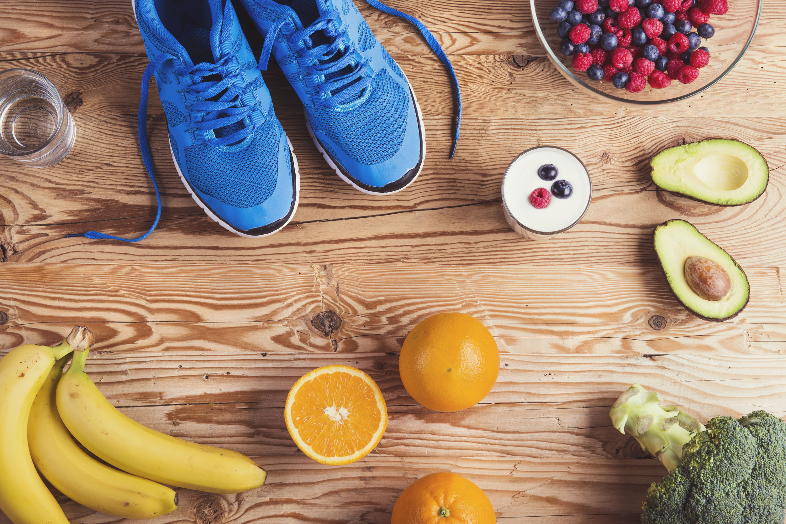 Pair of running shoes and healthy food